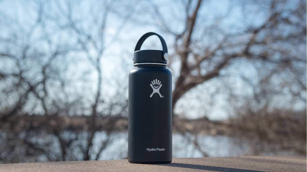 Black Hydro Flask on concrete
