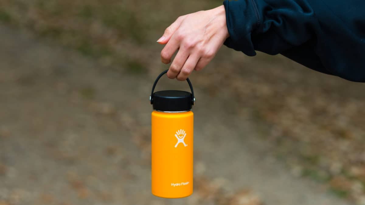 Hiker holding a Hydro Flask