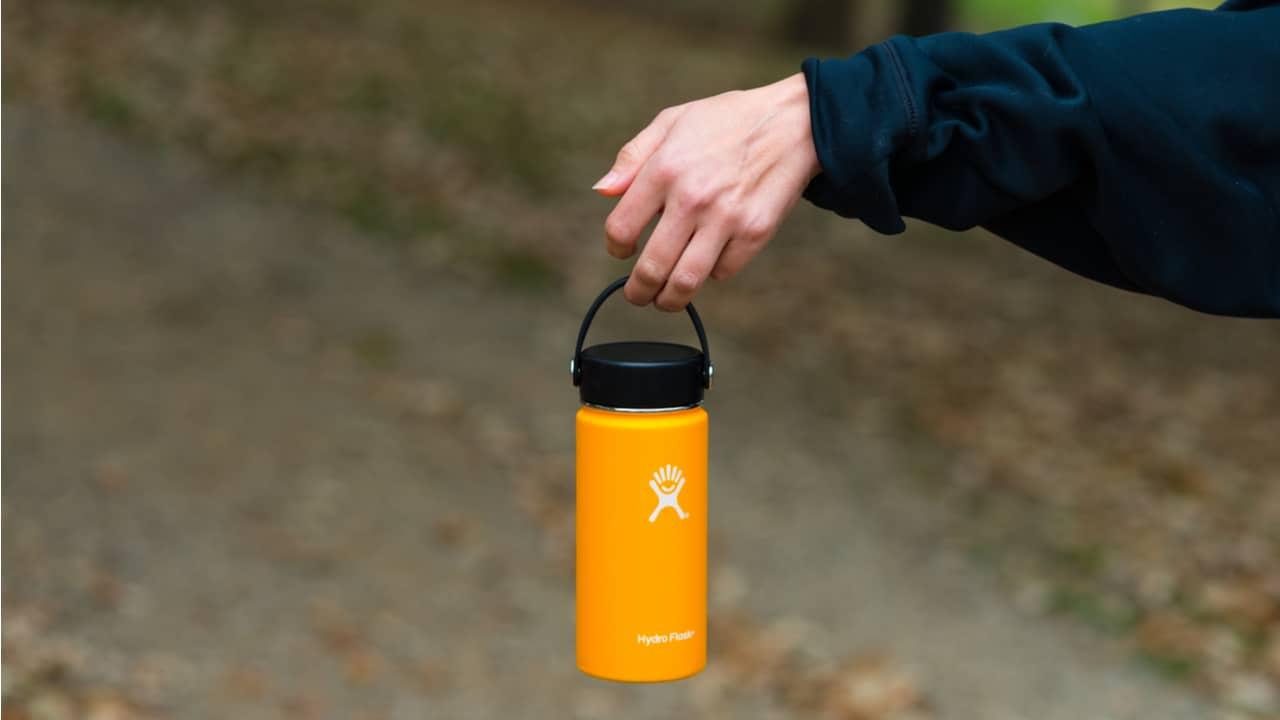 Hiker holding a hydro flask bottle