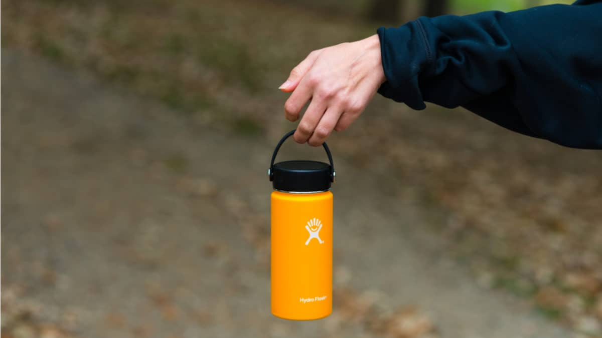 Hiker with a yellow Hydro Flask