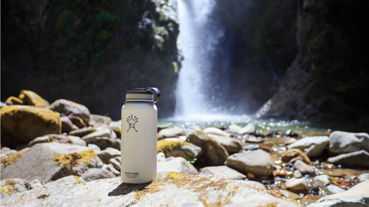 Hydro Flask in front of a waterfall