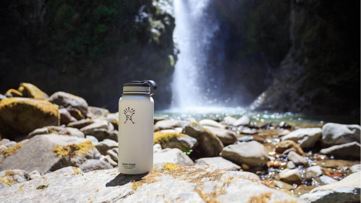Hydro Flask beneath a waterfall