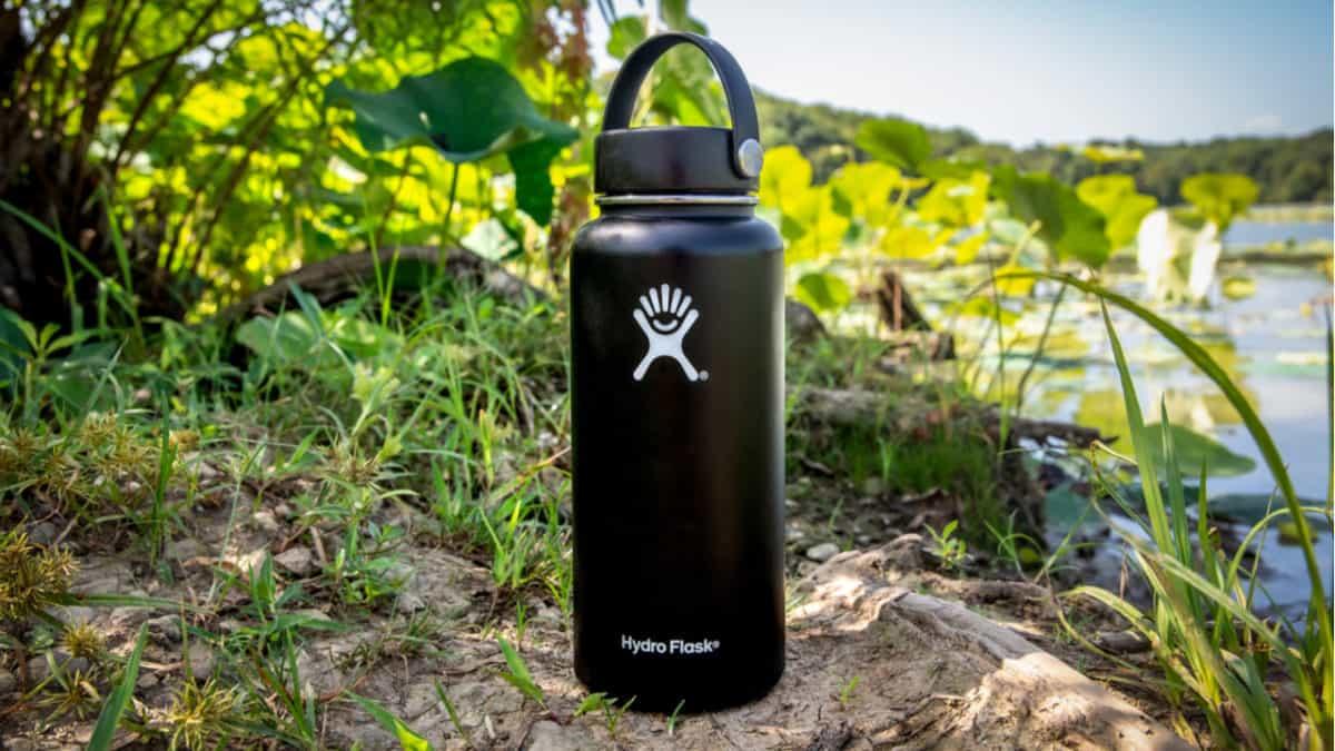 Hydro Flask bottle sitting on a shore