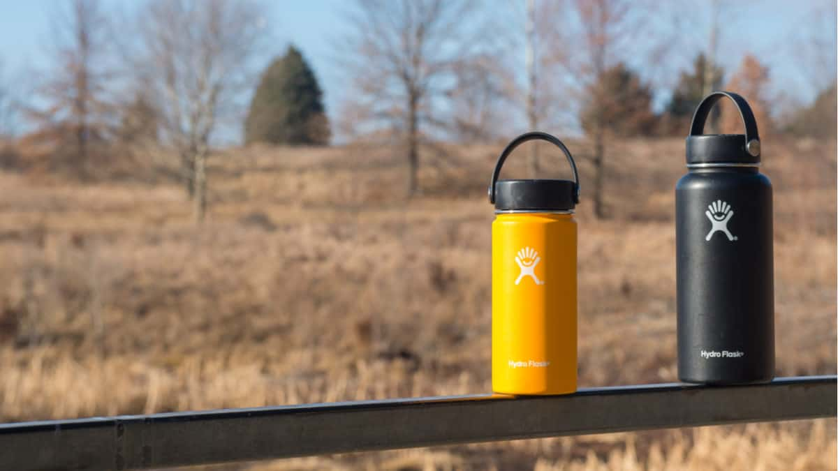 Hydro Flask bottles on a fence