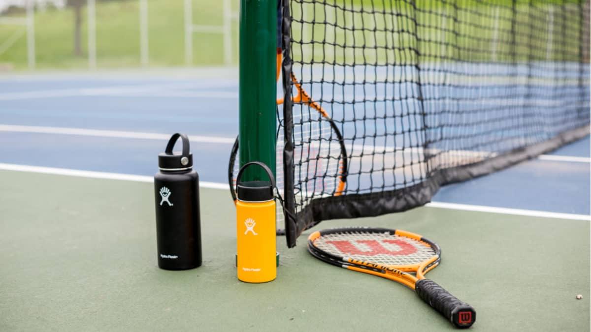 Hydro Flasks on a tennis court